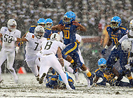 Philadelphia, PA - December 9, 2017:   Navy Midshipmen running back Malcolm Perry (10) hurdles  a player during the 118th game between Army vs Navy at Lincoln Financial Field in Philadelphia, PA. (Photo by Elliott Brown/Media Images International)