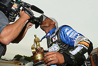 Sept. 30, 2012; Madison, IL, USA: NHRA top fuel dragster driver Antron Brown celebrates by kissing the ESPN camera after winning the Midwest Nationals at Gateway Motorsports Park. Mandatory Credit: Mark J. Rebilas-