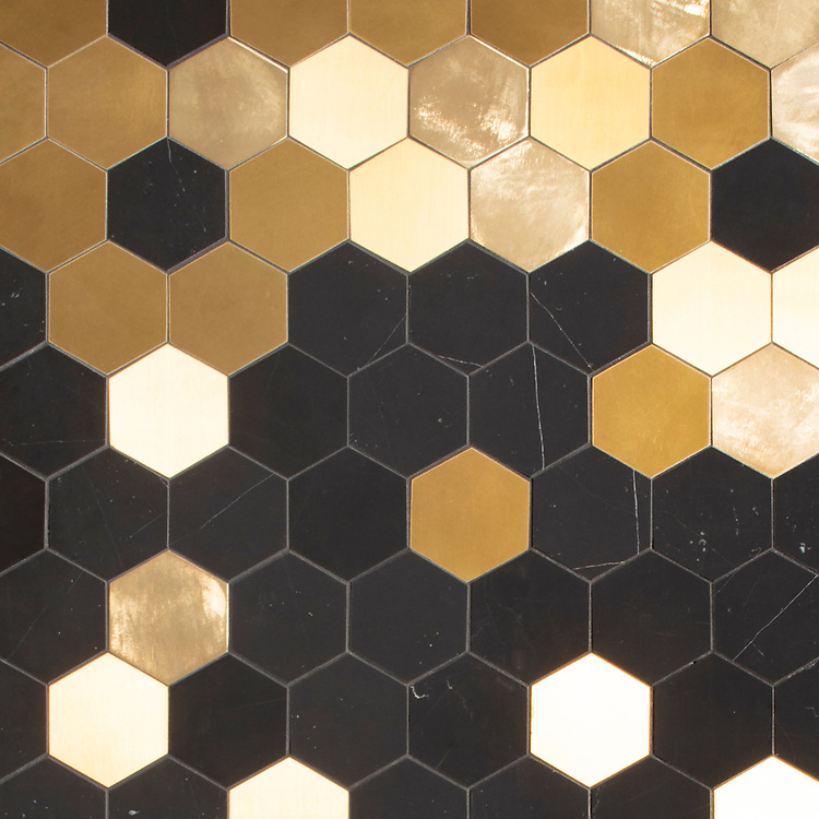 Huxley Grand, a waterjet cut stone mosaic, shown in honed Nero Marquina with brushed and velvet finished brass, is part of the Bright Young Things™ collection by New Ravenna.