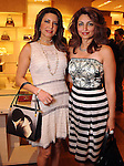 Parissa and Mahzad Mohajer at an evening honoring The Houston Symphony Young Associates Council at the Louis Vuitton store in the Galleria Thursday August 15, 2013.(Dave Rossman photo)