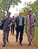 "Washington, D.C. - May 17, 2005 -- George Galloway , Member of Parliament for Bethnal Green and Bow , Great Britain, walks on Capitol Hill after giving testimony before the United States Senate Committee on Homeland Security and Governmental Affairs Permanent Subcommittee on Investigations hearing on ""Oil For Influence: How Saddam Used Oil to Reward Politicians Under the United Nations Oil-for-Food Program"" in Washington, D.C. on May 17, 2005. At left is Parliamentary Assistant Asad Rehman, Ron McKay (at rear with cell phone), Galloway, and unidentified.  .Credit: Ron Sachs / CNP"