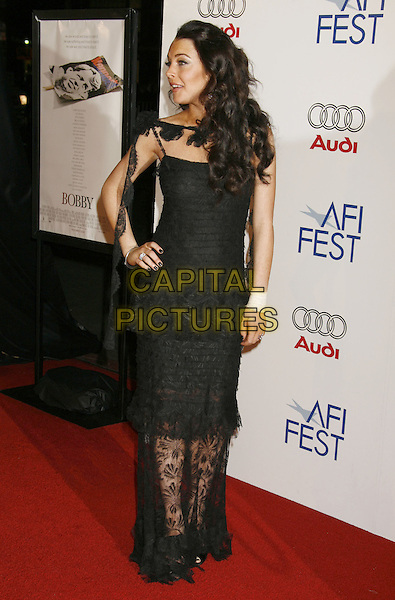 "LINDSAY LOHAN.AFI Fest 2006 Opening Night Gala and US Premiere of ""Bobby"" held at Mann's Chinese Theatre, Hollywood, California, USA..November 1st, 2006.Ref: ADM/RE.full length black lace dress hand on hip profile.www.capitalpictures.com.sales@capitalpictures.com.©Russ Elliot/AdMedia/Capital Pictures."