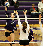 SIOUX FALLS, SD - OCTOBER 4:  Michelle Ritland #12from the University of Sioux Falls hammers a kill past Rachel Fagerburg #6 from Minot State during their game Saturday afternoon at the Stewart Center. (Photo/Dave Eggen/Inertia)