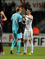 Sunday, 28 November 2012<br /> Pictured L-R: Goalkeeper Gerhard Tremmel and team mate Ki Sung Yueng of Swansea congratulate each other at the end of the game<br /> Re: Barclays Premier League, Swansea City FC v West Bromwich Albion at the Liberty Stadium, south Wales.