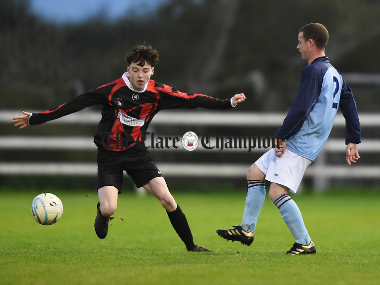 Darragh Mc Dade of Shannon Hibs in action against Greg Howard of Lifford B during their Division 3 League Cup final at Doora. Photograph by John Kelly.