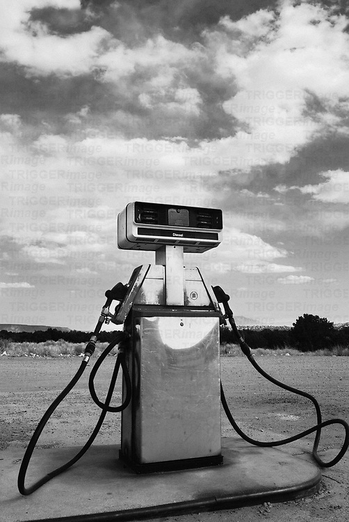 gas pump contrasts the natural landscape environment at big chief gas station, san ysidro, new mexico