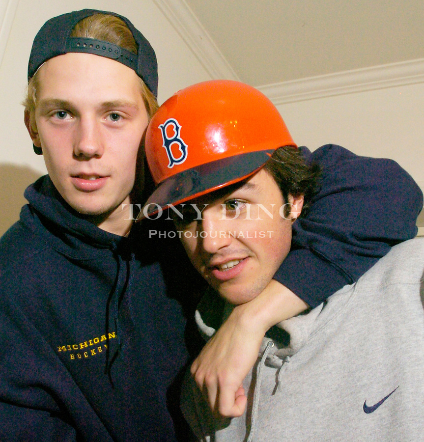 Michigan hockey players Brandon Rogers (right) and Matt Hunwick, at their apartment on Monday, October 18, 2004 in Ann Arbor, Mich. (TONY DING/Daily)
