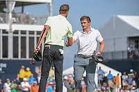 Kevin Tway (USA) shakes hands with Paul Dunne (IRE) on 18 following round 4 of the Houston Open, Golf Club of Houston, Houston, Texas. 4/1/2018.<br /> Picture: Golffile | Ken Murray<br /> <br /> <br /> All photo usage must carry mandatory copyright credit (&copy; Golffile | Ken Murray)