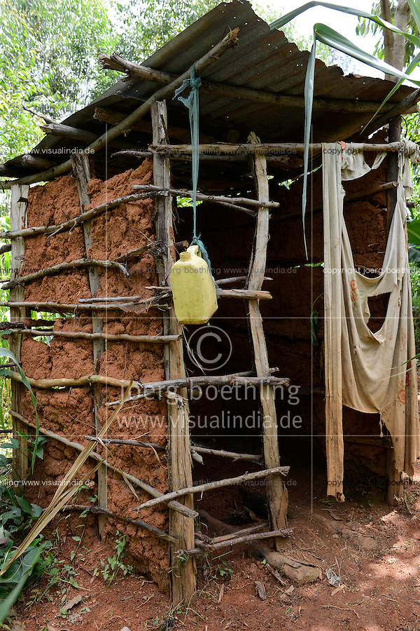 KENYA, Kisumu County, Kaimosi, toilet built from clay, timber and tinshed in village/ KENIA, Toilette aus Lehm, Holz und Wellblech in einem Feld in einem Dorf