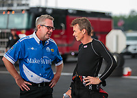 Aug 19, 2018; Brainerd, MN, USA; NHRA funny car driver Tommy Johnson Jr (left) with top fuel driver Clay Millican during the Lucas Oil Nationals at Brainerd International Raceway. Mandatory Credit: Mark J. Rebilas-USA TODAY Sports