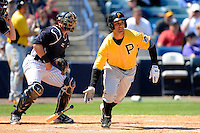 Pittsburgh Pirates outfielder Andrew Lambo #56 at bat in front of catcher Francisco Cervelli during a Spring Training game against the New York Yankees at Legends Field on March 28, 2013 in Tampa, Florida.  (Mike Janes/Four Seam Images)