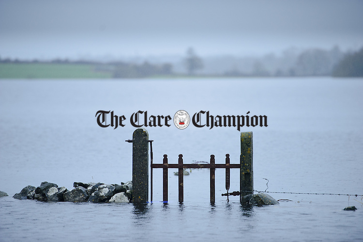 Flood waters rise around the Coleman family farm and home in the Loughinwada area near Peterswell in South Galway. Photograph by John Kelly.