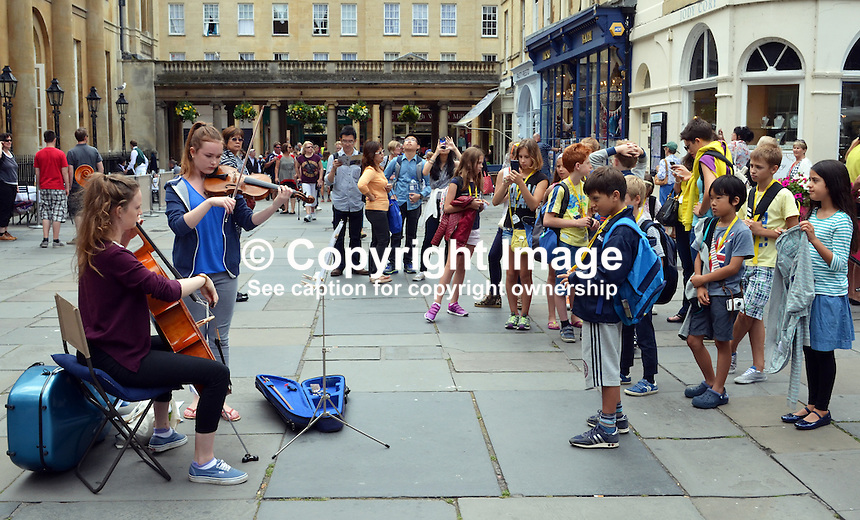 Two girl musicians busking in the precincts of The Pump Room &amp; Bath Abbey, Bath, Somerset, UK. 201407073348<br /> <br /> Copyright Image from Victor Patterson, 54 Dorchester Park, Belfast, UK, BT9 6RJ<br /> <br /> Tel: +44 28 9066 1296<br /> Mob: +44 7802 353836<br /> Voicemail +44 20 8816 7153<br /> w: victorpatterson.com<br /> <br /> e1: victorpatterson@me.com<br /> e2: victorpatterson@gmail.com<br /> <br /> <br /> IMPORTANT: Please see my Terms and Conditions of Use at www.victorpatterson.com