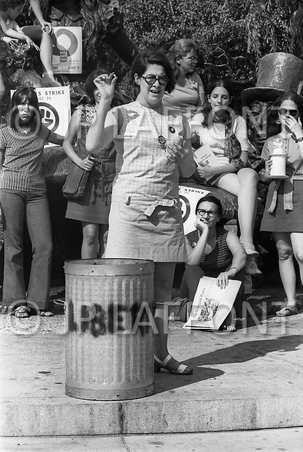 Manhattan, New York City, NY. August 26th, 1970.<br /> 25.000 women marched on the 5th Ave. for women's rights.<br />  An extremist of NOW symbolically throws a wedding ring in a trash can, together with other objects symbolizing the female sex.