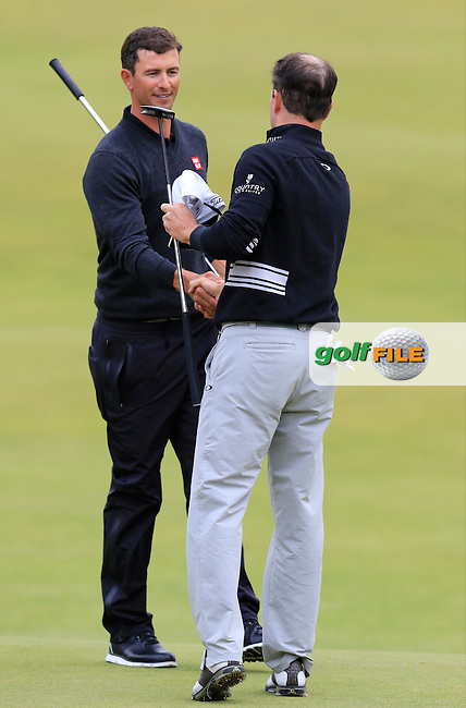 Adam Scott (AUS) and Zach Johnson (USA) finish on the 18th hole during Sunday's Round 3 of the 144th Open Championship, St Andrews Old Course, St Andrews, Fife, Scotland. 19/07/2015.<br /> Picture Eoin Clarke, www.golffile.ie