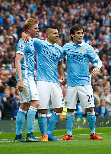 03.10.2015. Manchester, England. Barclays Premier League. Manchester City versus Newcastle United. Manchester City midfielders Kevin de Bruyne and David Silva congratulate Manchester City striker Sergio Agüero after he scores the sixth goal.