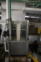 An old type dyeing machine at Prem Industry's dyeing factory  in Tirupur, Tamilnadu. India is now producing international quality dyeing machine at a cheaper price. After lifting of quota system in textile export on 1st january 2005. Tirupur has become the biggest foreign currency earning town of India.