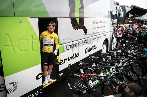 03.07.2016. Normandy, France. Tour de France Stage 2 from Saint-Lo to Cherbourg en-Cotentin. Mark Cavendish emerges from the team bus in the leaders yellow jersey.