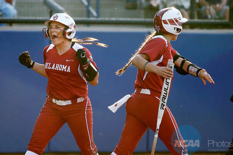 07 JUNE 2016:  Oklahoma outfielder Erin Miller (48) and Oklahoma infielder Sydney Romero (2) celebrate during the Division I Women's Softball Championship is held at ASA Hall of Fame Stadium in Oklahoma City, OK.  Shane Bevel/NCAA Photos