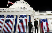 Marine Lieutenant Colonel Tim Stefanick and Captain David Kinzler watch the setup for the Presidential Inauguration on the West Front of the United States Capitol before dawn Monday, January 21, 2013. U.S. President Barack Obama will be sworn-in again this morning for his second term.   .Credit: Chris Maddaloni / Pool via CNP