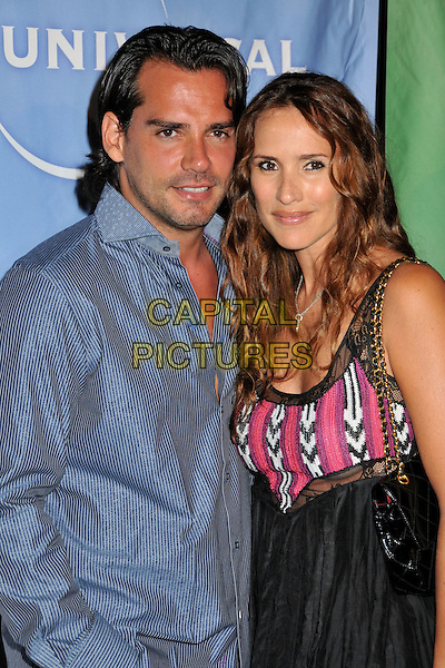CRISTIAN DE LA FUENTE & ANGELICA CASTRO.NBC Universal's TCA Press Tour Party 2009 held at the Langham Huntington Hotel & Spa, Pasadena, CA, USA..August 5th, 2009.half length pink white black dress pattern married husband wife blue striped top stubble facial hair .CAP/ADM/BP.©Byron Purvis/AdMedia/Capital Pictures.