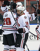 Mike Hewkin (NU - 28), Mike McLaughlin (NU - 18) - The Northeastern University Huskies defeated the St. Thomas Tommies 7-5 in their exhibition match on Saturday, October 3, 2009, at Matthews Arena in Boston, Massachusetts.