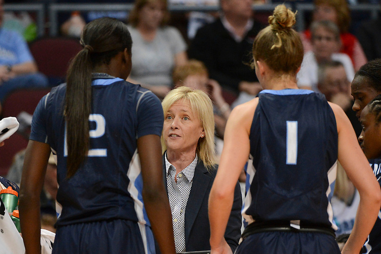 March 7, 2014; Las Vegas, NV, USA; San Diego Toreros head coach Cindy Fisher instructs in a team huddle against the Saint Mary's Gaels during the first half of the WCC Basketball Championships at Orleans Arena.