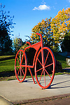 Red bicycle racks in the shape of a bike located in Caras park in Missoula, Montana