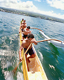 USA, Hawaii, The Big Island, Hilo, a team of men row an Outrigger Canoe in Hilo Bay