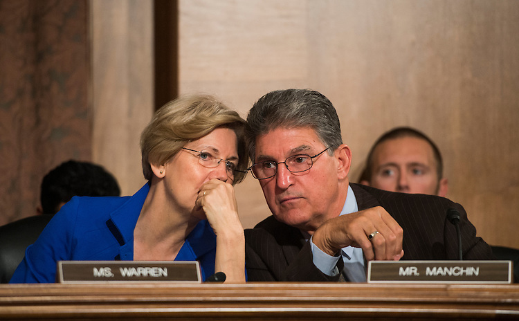 "UNITED STATES - OCTOBER 10: From left, Sen. Elizabeth Warren, D-Mass., and Sen. Joe Manchin, D-W. Va., talk during the Senate Banking, Housing and Urban Affairs Committee hearing on ""Impact of a Default on Financial Stability and Economic Growth"" on Thursday, Oct. 10, 2013. (Photo By Bill Clark/CQ Roll Call)"
