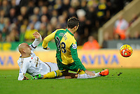 Jonjo Shelvey of Swansea City taclkes Gary O'Neil of Norwich City during the Barclays Premier League match between Norwich City and Swansea City played at Carrow Road, Norwich on November 7th 2015
