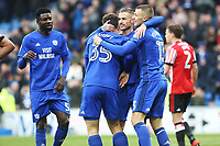 Anthony Pilkington of Cardiff City celebrates scoring his sides fourth goal of the match with Yanic Wildschut and Joe Bennett during the Sky Bet Championship match between Cardiff City and Sunderland at the Cardiff City Stadium, Wales, UK. Saturday 13 January 2018
