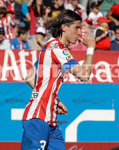Atletico de Madrid's Filipe Luis celebrates goal during La Liga match.April 14,2013. (ALTERPHOTOS/Acero)