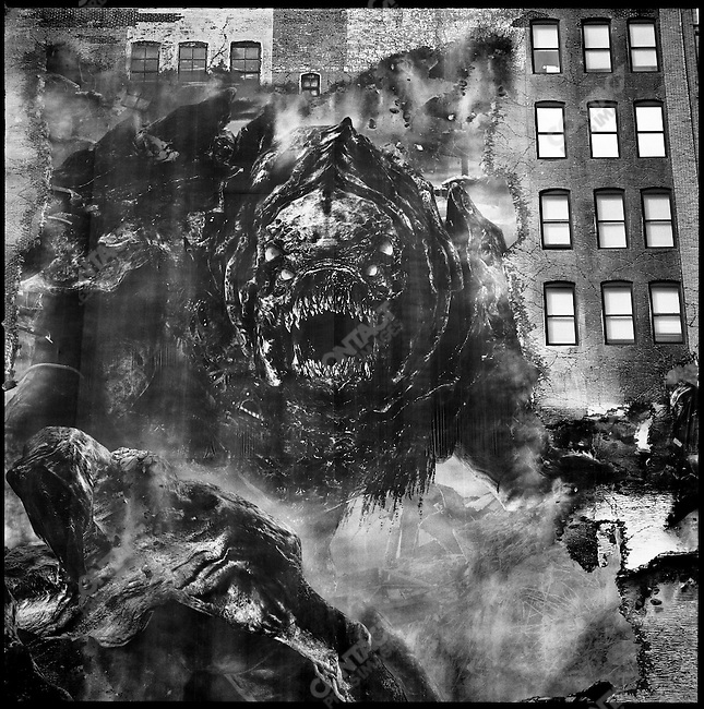 The side of a building on 33rd Street and 8th Avenue Street was covered by the advertisement for a gaming programme represented by a monster. New York City, New York, November 12, 2008