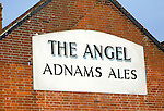 The Angel, Adnams Ales pub sign on side of building, Halesworth, Suffolk, England
