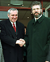 Irish Prime Minster Bertie Ahern shakes hands with Sinn Fein President Gerry Adams during his first tour of west Belfast, Monday December 8, 1997, after visiting a west Belfast Business park before going of to Stormont Castle Buildings to meet other political parties at the Northern Ireland Talks. (AP Photo/Paul McErlane)