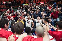 VALENCIA, SPAIN - 05/12/2014. Aficionados del Estrella Roja celebrando la victoria al final del partido. Pabellon Fuente de San Luis, Valencia, Spain.