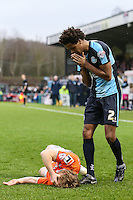 Sido Jombati of Wycombe Wanderers (right) looks concerned after his boot struck the face of Craig Mackail-Smith of Luton Town (left) during the Sky Bet League 2 match between Wycombe Wanderers and Luton Town at Adams Park, High Wycombe, England on 6 February 2016. Photo by David Horn.