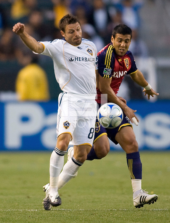 LA Galaxy midfielder Dema Kovalenko battles Real Salt Lake midfielder Javier Morales. Real Salt Lake defeated the LA Galaxy 2-0 at Home Depot Center stadium in Carson, California on Saturday June 13, 2009.   .