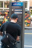 Man buying a CitiBike pass on West Broadway in the Manhattan neighborhood of Soho.