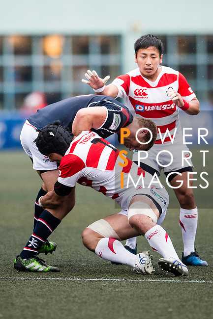 Naoki Ozawa of Japan (R) puts a tackle on Dylan Rogers of Hong Kong (L) during the Asia Rugby Championship 2017 match between Hong Kong and Japan on May 13, 2017 in Hong Kong, China. Photo by Marcio Rodrigo Machado / Power Sport Images