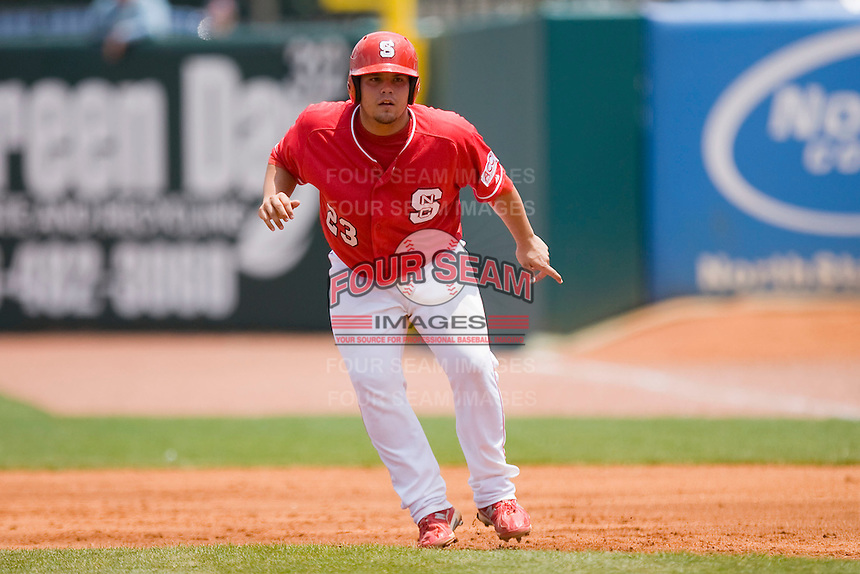 Danny Canela #23 of the North Carolina State Wolfpack takes his lead off of first base against the Florida State Seminoles during the Championship Game of the 2010 ACC Baseball Tournament at NewBridge Bank Park May 30, 2010, in Greensboro, North Carolina.  The Seminoles defeated the Wolfpack 8-3.  Photo by Brian Westerholt / Four Seam Images