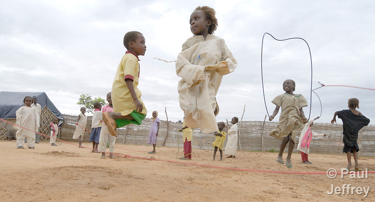 Children at play in a camp near Bilel, where families displaced by the conflict in the Darfur region of Sudan have taken refuge from the violence.