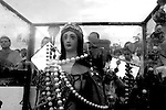 """A statue of Yemanja, the """"Goddess of the Sea"""", is seen in a glass box, during the celebrations of Yemanja in Ramirez beach, Montevideo, Uruguay. Acoording to Mae Susana about 500.000 people take part in the celebrations, part of them believers of the Umbanda religion, and part of them believers of other religions. Believers pay tribute February 2 to Yemanja, asking for work, love and money. Photo by Quique Kierszenbaum"""