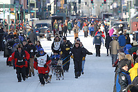 Paul Gebhart leads his puppy team down 4th avenue and to the starting line for his handler/musher Kristy Berington during the ceremonial start of the 2011 Iditarod in Anchorage, Alaska