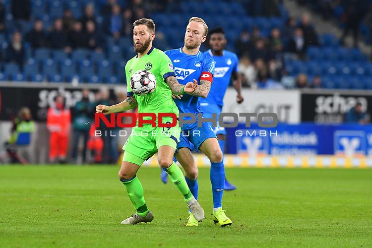 01.12.2018, wirsol Rhein-Neckar-Arena, Sinsheim, GER, 1 FBL, TSG 1899 Hoffenheim vs FC Schalke 04, <br /> <br /> DFL REGULATIONS PROHIBIT ANY USE OF PHOTOGRAPHS AS IMAGE SEQUENCES AND/OR QUASI-VIDEO.<br /> <br /> im Bild: Guido Burgstaller (FC Schalke 04 #19) gegen Kevin Vogt (TSG Hoffenheim #22)<br /> <br /> Foto © nordphoto / Fabisch