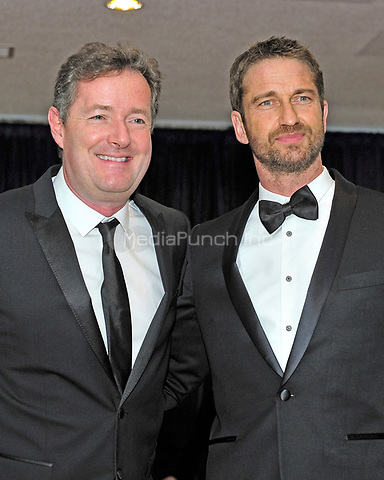 Piers Morgan and Gerard Butler arrive for the 2013 White House Correspondents Association Annual Dinner at the Washington Hilton Hotel on Saturday, April 27, 2013.<br /> Credit: Ron Sachs / CNP<br /> (RESTRICTION: NO New York or New Jersey Newspapers or newspapers within a 75 mile radius of New York City) /MediaPunch