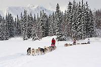 Ramey Smyth Dee Dee Jonrowe & John Barron teams mushing together near Finger Lake Chkpt 2006 Iditarod Alaska