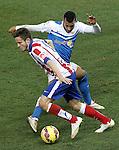 Atletico de Madrid's Saul Niguez (l) and UD Almeria's Michel Macedo during La Liga match.February 21,2015. (ALTERPHOTOS/Acero)