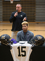 NWA Democrat-Gazette/BEN GOFF @NWABENGOFF<br /> Jody Grant, Bentonville head football coach, talks about Donte Jones, Bentonville football player, signs his national letter of intent to play at Central Arkansas Wednesday, Feb. 6, 2019, during a signing ceremony at Bentonville's Tiger Arena.